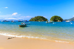 Boat sea mountains Abraao Beach of island Ilha Grande, Brazil royalty free stock images