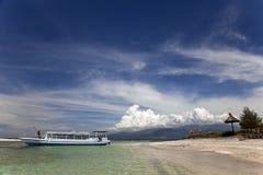 Boat on sea near the beach. Man on the boat near the paradise island Stock Photography