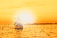 Boat in the sea with orange  sky Royalty Free Stock Photos
