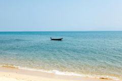 A boat in the sea. Without people near a deserted beach Royalty Free Stock Image