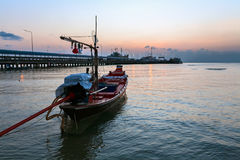 Boat and sea port at sunset Stock Image