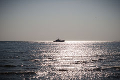 The boat on the sea stock photography