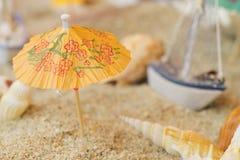 Boat sea shells on sandy tropical beach. Royalty Free Stock Photo