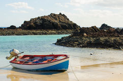 Boat on the sea shore. Boat on the edge of the beach, on the island of Lobos, north of Fuerteventura (Canary Islands Royalty Free Stock Photography
