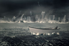 Boat on the sea with sinking city Royalty Free Stock Photos