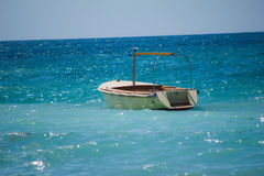 Boat in the sea. A small boat bobs on the waves of the sea Royalty Free Stock Photos