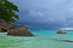 Boat at sea before the storm. Thailand summer seascape. Similan islands. Boat at sea before the storm Stock Photos