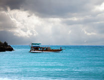 Boat in the sea and stormy sky Stock Photo