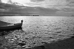 BOAT SEA SUNLIGHT AND HARBOR VINTAGE RETRO Stock Image