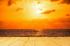 Boat on the sea in sunrise or sunset period with empty wooden pi Stock Images
