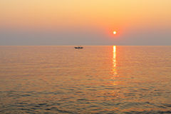 Boat in the sea at sunset. Royalty Free Stock Photos