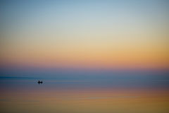 Boat in the sea at sunset Royalty Free Stock Image