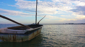 BOAT ON THE SEA. Boat in the sea to the dawn, adrift Stock Image