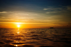 Boat and sunset Royalty Free Stock Photos
