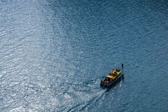 Boat on the sea turns. Boat with people making a turn in the sea Royalty Free Stock Photo