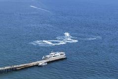 Boat among sea waves Stock Image