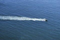 Boat among sea waves Royalty Free Stock Photo