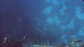 Boat on seabed near Salem Express shipwrecks underwater in Red Sea in Egypt. Extreme tourism on ocean floor in world of coral reefs, fish, sharks. Researchers stock footage
