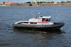 Boat of search and rescue services. SAINT-PETERSBURG, RUSSIA - JULY 31, 2016: Boat of search and rescue services on the Neva River, St. Petersburg, Russia Stock Images