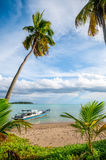 Boat at the seashore. Tropical island and a boat at the seashore royalty free stock photo