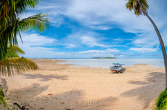 Boat at the seashore. Tropical island photographed with fisheye lens Royalty Free Stock Photos