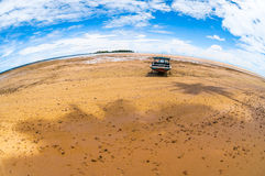 Boat at the seashore. Tropical island photographed with fisheye lens Stock Photo