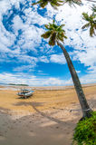 Boat at the seashore. Tropical island photographed with fisheye lens Stock Photos