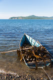 Boat with seaweed kelp Royalty Free Stock Image
