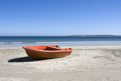 Boat on a secluded beach in South Africa. Boat on a secluded beach in Paternoster, South Africa on a sunny day Royalty Free Stock Image