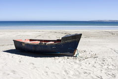 Boat on a secluded beach in South Africa Stock Images