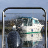 Boat seen through a wet window Royalty Free Stock Image