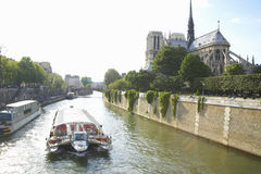 Boat on the Seine River with the Notre Dame Cathedral to the right, Paris, France Stock Photography