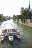 Boat on the Seine River with the Notre Dame Cathedral to the right, Paris, France Royalty Free Stock Photography