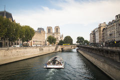 Boat in the Seine river in Paris, France Royalty Free Stock Image