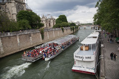 A boat on the Seine River in Paris Royalty Free Stock Images