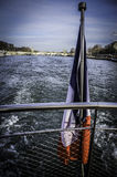 Boat on Seine. The stern of a boat with the French flag on the river Seine Stock Photos