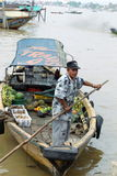 Boat seller at Musi River, Palembang, Indonesia. Palembang, Indonesia. November 2011: Unidentified man paddling the boat to sell fruits at Musi River in Stock Images