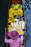 Boat selling fruit. In floating market in Thailand Stock Photography