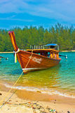 A boat server. A beach is beautiful, a sea green water,   the sky is blue, a cloud  white Stock Images