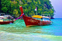 A boat server. A beach is beautiful, a sea green water,   the sky is blue, a cloud  white Royalty Free Stock Image