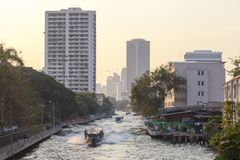 Boat service at Khlong channel in Bangkok. The Khlong Saen Saep Express Boat service operates on the Khlong Saen Saep in Bangkok, providing fast, inexpensive Royalty Free Stock Image