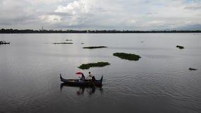 Boat service traveler tour around lake at U Bein Wooden longest Bridge stock video