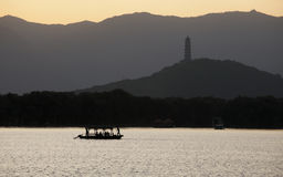 Boat in the setting sun Stock Photo