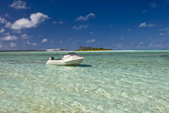 Boat in shallow, tropical water in lagoon. Stock Images