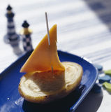 Boat-shaped mashed potato and cheddar appetizer Royalty Free Stock Photo