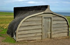 Shed made from fishing boat Stock Photos