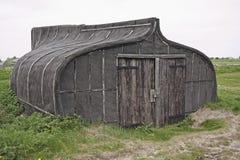 Boat shed. A storage shed,shaped like a boat on Lindesfarne Stock Image
