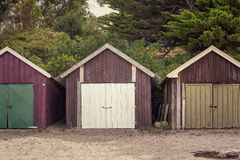 Boat sheds on the beach Royalty Free Stock Images