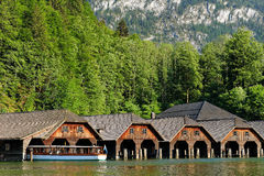 Boat sheds mountain lake idyll with electric boat Stock Images