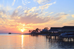 Boat Sheds Sunset. Colorful sunset and boats sheds off the coast of Gulf Breeze, Florida Stock Photography